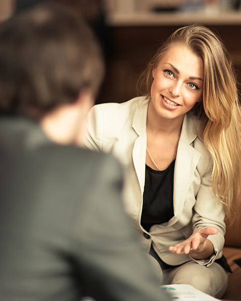 Smartly dressed  female talking during a meeting
