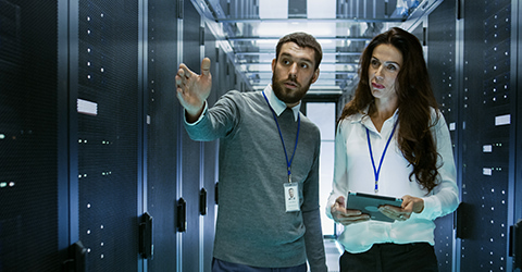 Man and woman talking in a server room